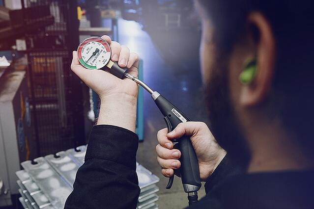 Man-with-Pro One-airgun-OSHA-gauge.jpg